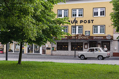Time Machine (Alexander Pugatschewski) Tags: ilmenau thuringia germany city street cityscape houses signs cyclist pedestrianpassage pavement province quiet tranquility travel urban car time machine trabant hotel restaurant guest house
