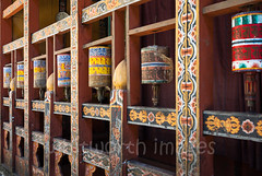 Inside Trongsa Dzong (whitworth images) Tags: painted administration building buddhist large himalaya himalayas intricate bhutan enormous culture buddhism interior travel decorated dilapidated frame detail ancient railing historic pray inside dzong worship worn wooden wheel monastery asia fortress stone government mantra religious religion prayerwheels carved huge leather old architecture trongsa cylinder trongsadzong prayer traditional