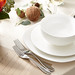 Thanksgiving minimalist table setting with silverware, plates and a bowl