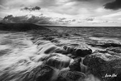 monsoon waves (Azam Alwi) Tags: longexposure seascape stone landscape wave slowshutter stonebeach fujifilmxt1
