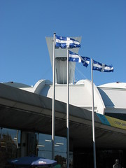 Olympic Stadium (Montreal) (Terry Hassan) Tags: canada tower architecture modern quebec montreal flag observatory olympicstadium olympicpark funicular stadeolympique parcolympique
