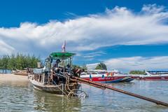 longtail boat (dominiquesainthilaire) Tags: thailand seascape longtailboat sailors krabi aonang clouds thailande bateau marins nikon nikond7100 coth5 travelplanet ngc worldtrekker infinitexposure thisphotorocks greatphotographers aasia awsomeasia