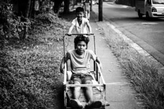 Traveling in style. (glenn_pamatmat) Tags: up children philippines diliman portraitproject