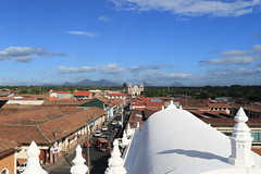 Leon Cathedral, Nicaragua (tik_tok) Tags: street old city travel roof sky building tourism church latinamerica architecture clouds religious town exterior cathedral religion bluesky landmark structure roofs leon nicaragua tall overhead touristattraction centralamerica