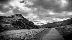 Path & Peak on Arthur's Seat (CarnivoreDaddy) Tags: uk sky bw grass clouds landscape scotland blackwhite nikon edinburgh britain path hill dramatic kitlens peak stormy hills 1855 arthursseat d3200