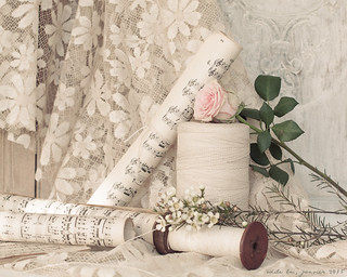 Still life with thread, music sheets and a rose...