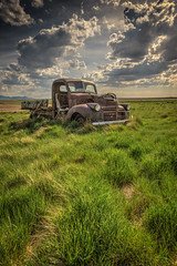 Lets Not Pretend (Wayne Stadler Photography) Tags: canada cars abandoned rural countryside rust farm country rusty alberta weathered trucks aged discarded prairies derelict automobiles southernalberta rustographer travelvehicles