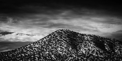 Hill In Galisteo (Mabry Campbell) Tags: winter sky blackandwhite usa snow newmexico santafe monochrome landscape outdoors photography countryside photo december photographer image cloudy unitedstatesofamerica hill fav20 hasselblad photograph 100 f11 galisteo fineartphotography 80mm 2015 commercialphotography fav10 santafecounty hc80 sec mabrycampbell h5d50c december232015 20151223campbellb0000165