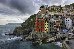 Riomaggiore - Cinque Terre (Italy) (luke.switzerland) Tags: houses sea italy seascape water colors sunrise long exposure liguria cliffs terre cinque riomaggiore