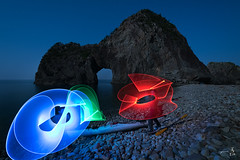 In a galaxy far far away (gmacfly) Tags: ocean moon beach rock japan night fun star sticks glow calm full