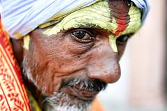 Sadhu by Varanasi (Ma Poupoule) Tags: portrait india yellow jaune eyes asia portrt yeux varanasi asie visage inde bnars