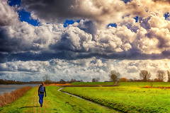 Destiny Unknown (Alfred Grupstra Photography) Tags: lake man clouds landscape walk dike ijselmeer