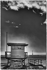 Lifeguard Tower On Its Own (Rolf Siggaard) Tags: beach building clouds mirrorless losangeles santamonica sky shapes structure architecture fujix100s environmental sunset 23mmapsc monochrome niksilverefexpro2 fujifilmx100s
