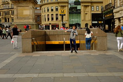 Larking around (Victor W Adams) Tags: boy lad youth youngster newcastle newcastleupontyne street streetphotography streetscape urban city citylife cityscape town social documentary greystreet england gb greatbritain uk monument grey greys metro larking pose posing fuji xe1 digital