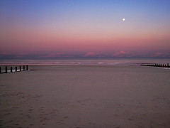 St Mary's Bay, Kent, Nr Dymchurch. In Summer, crowded, at other times, a vast open space at low tide. In this picture from May 2004, under a bright full moon (Cockedhat1) Tags: sands blue shoreline sunset lowtide purple isolated bleak pinkclouds seascape brown stmarysbay kent waves