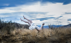 Dragged Down the Rabbit Hole (vanessa.smith) Tags: conceptual whimsical aliceinwonderland eerie horror selfportrait mountains lost sky whitedress barefoot chains conceptualportrait levitate falling deadgrass upsidedown girlfalling field vanessasmithphotography conceptualphotography