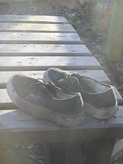 Plimsoll picnic (Nekoglyph) Tags: sunlight black abandoned forest table shoes pumps walkway lensflare muddy guisborough plimsolls
