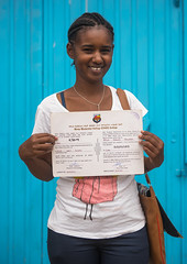 A karrayyu tribe girl called aliya who was the first girl educated in her tribe showing her diploma, Oromia, Metehara, Ethiopia (Eric Lafforgue) Tags: africa portrait people color vertical modern outdoors photography education day diploma african tribal teenager blackpeople ethiopia tribe ethnic oneperson developingcountry graduated hornofafrica ethiopian eastafrica thiopien etiopia abyssinia ethiopie etiopa blackskin lookingatcamera oromia oromo waistup  etiopija africanethnicity 1people ethiopi  ethnicgroup etiopien etipia  etiyopya  metahara         kereyu modernityandtradition karrayyu metehara karrayu kararyu ethio161014
