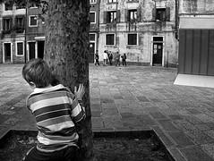 hide-and-seek (Maurizio Targhetta) Tags: city venice boy people play citylife streetphotography hideandseek blackandwhitebw