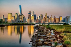 (mitzgami) Tags: reflection longexposure newjersey city jerseycity libertystatepark hudsonriver oneworldtradecenter onewtc nyc newyorkcity lowermanhattan inexplore flickr photography building buildings landscapes landscape sunset