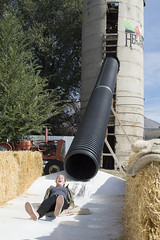 Rough Exit from the Silo Slide (aaronrhawkins) Tags: slide silo thrill pipe fun heehawfarms farm october hay tube girl landing exit fast pleasantgrove utah family halloween aaronhawkins