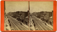 Iowa Sterographs Main Street, West Side, South Corner, Dubuque (State Historical Research Centers of Iowa) Tags: brick mainstreet iowa ia stereoview streetcar dubuque businesses cornice nineteenthcentury horsecarriage commercialarchitecture bootshop commercialsignage revolutionstore grosvenorandharger mulfordandwhitingshirtfactory paultrautandcowholesaleliquor dubuquecountybank grandcentralbilliardhall viewsofdubuque