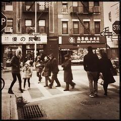 Crossing lives. (robindiakhate) Tags: street city nyc chinatown pedestrians hipstamatic janelens oggl rasputinfilm