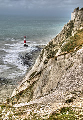 Beachy Head 1 (Raphooey) Tags: uk light sea england cliff cloud lighthouse english rock clouds sisters canon eos sussex chalk rocks waves head south gap wave cliffs east seven eastbourne gb southeast hdr channel beachy birling photomatix 70d hoiuse