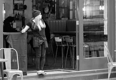 Where did all my customers go? (Just Ard) Tags: street uk urban bw woman white black girl monochrome hat wales bar photography prime mono pub nikon candid cymru cardiff streetphotography 85mm caerdydd waitress nikkor unposed primelens d7000 justard justardcom