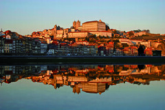 Reflex Cityscape of Porto Town (xpress.portugal) Tags: old city travel sunset tourism portugal water horizontal architecture river landscape golden pier canal reflex spain europe cityscape realestate wine antique jetty porto oldtown oporto ribeira watercourse portwine douroriver urbanscene socialhistory duororiver traveldestinations famousplace buildingexterior commercialdock patrimonyofhumanity thedouro builtstructure lookingatview