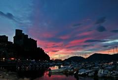 Lerici al tramonto (nene/aww) Tags: pink blue sea italy castle sunshine clouds landscape boats tramonto nuvole mare liguria barche porto romantic castello molo scogli laspezia lerici