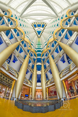 Golden Interior of Burj Al Arab (M.Omair) Tags: travel color building beautiful gold golden nikon colorful dubai united restaurants landmark fisheye emirates arab burjalarab shops inside fountains stay burj foutain interier touristdestination imomair