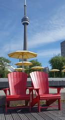 Summer Under CN Tower (kaprysnamorela) Tags: lake toronto ontario canada cntower harbourfront umbrellas muskokachair samsungedge