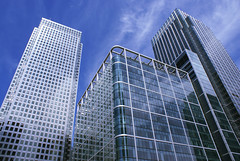 Buildings (caprightmarketing) Tags: new city uk blue england sky urban sunlight reflection building london tower industry window glass wall architecture modern facade skyscraper silver square corporate office big high construction cityscape exterior bright steel centre perspective center business wharf tall canary success financial futuristic finance buildingconstruction commercialbuilding commercialbuildings