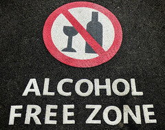 Alcohol Free Zone (Steve Taylor (Photography)) Tags: road red newzealand white black glass tarmac sign circle bottle stencil wine path nelson diagonal nz southisland alcoholfreezone