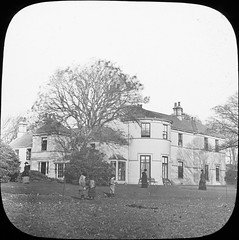"""Big House with figures"" is Government House, Isle of Man (National Library of Ireland on The Commons) Tags: thomasholmesmason thomasmayne thomashmasonsonslimited lanternslides nationallibraryofireland children lawns locationidentified governmenthouse governorshouse isleofman douglas manxgovernment bemahaguefarm housedetectives lieutenantgovernoroftheisleofman lieutenantgovernor shuttlecock badminton henryloch baronloch henryloch1stbaronloch"