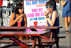 `1817 (roll the dice) Tags: brighton sussex beach fish sad mad funny natural people summer hot weather pretty sexy strangers portrait candid uk art classic urban unaware unknown england rock pier seafront amusement arcade marina fashion lunch bored canon tourism couple games magic pleasure money retro gamble choice twist popcorn fun streetphotography girls bn21tw sunglasses coke drink relax reaction shock bench wristband fag smoking cigarette chest smoke ride legs brunette