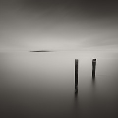 Empire Boat Ramp (Simos Xenakis) Tags: longexposure blackandwhite seascape motion sepia oregon dark bay boat sticks solitude fineart surreal peaceful minimal zen serene toned contemplative meditative