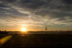 The daily way to work (fuhsaz) Tags: sky clouds sunrise landscape dawn austria meadow ironman pylon electricity powerpole