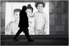 Seems armless (mesonparticle) Tags: street blackandwhite bw man silhouette kids night walking children child streetphotography x100t