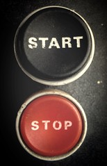 START or STOP? (joaobambu) Tags: red black macro topv111 closeup topv2222 start circle quote buttons circles topv1111 machine philosophy stop button blogged push topv3333 maquina