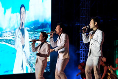 Singing trio (Roving I) Tags: suits events vietnam entertainment celebrations newyearseve singers concerts nightlife trios danang vocalists videoscreens