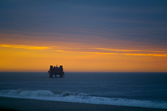 The Rig (DJawZ) Tags: ocean morning sky water clouds sunrise waves ship bottom nj dredge