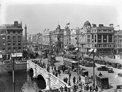 View of O'Connell Bridge and monument, Dublin (National Library of Ireland on The Commons) Tags: 1920s advertising 20thcentury trams eason automobiles oconnellstreet glassnegative benhur oconnellbridge nationallibraryofireland nelsonspillar easonson easoncollection tylersforboots easonphotographiccollection grandcentralcinema universityparkterenure hopkinshopkinsjewellers josephdownesbakery