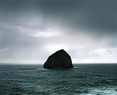 Haystacks of the ocean (Zeb Andrews) Tags: ocean seascape film oregon mediumformat landscape coast horizon symmetry pacificocean pacificnorthwest oregoncoast 6x7 haystackrock analogphotography thegreatoutdoors capekiwanda pentax6x7 kodakektar100