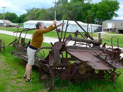 Catherine checking out some of the rusting farm machinery at Mound City Museum, Mound City, Missouri (ali eminov) Tags: people architecture buildings machinery catherine missouri museums implements farmmachinery moundcity moundcitymuseum