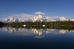 Colter Bay (Irwin Scott) Tags: lake reflection clouds boats wyoming grandtetons pinetrees colterbay snowymountains grandtetonnationalpark gtnp mtmoran