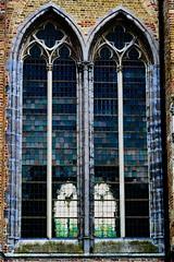 Through the glass in Damme (wellingtonandsqueak) Tags: belgium c1 damme churcg