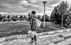 Pop corn seller (Saman A. Ali) Tags: park street boy portrait people blackandwhite monochrome photography blackwhite corn outdoor poor streetphotography photojournalism pop stphotografia