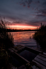 Sunset over a pond (Superfantti) Tags: sunset red pond wide sky clouds light shine reflection nikon d7200 finland water